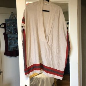 Over sized cream poncho.
